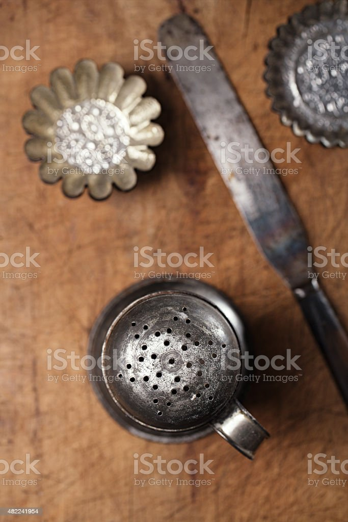 Vintage  Baking utensils - sifter, spatula, tins and moulds stock photo