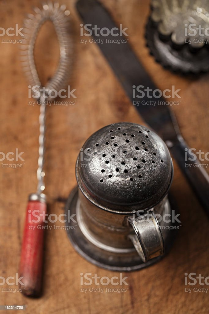Vintage  Baking utensils - sifter, whisk, spatula, tins and moul stock photo