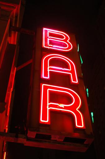 Vintage NYC bar sign on building.
