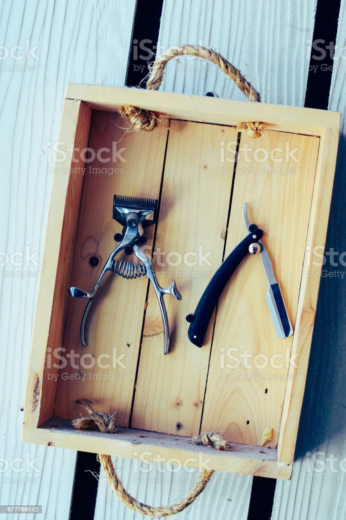 Vintage Barber cutter in wooden box. royalty-free stock photo