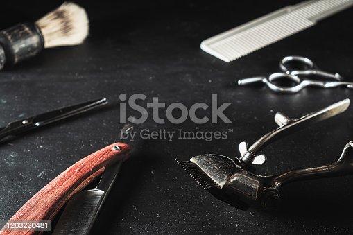 1131824191 istock photo vintage Barber shop equipment on Black background . Professional hairdressing tools. scissor, manual hairclipper, razor, shaving brush, comb 1203220481