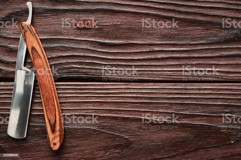 Vintage barber shop straight razor tool on wooden background stock photo