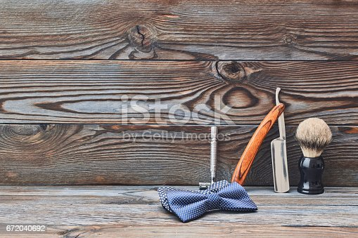 istock Vintage barber shop tools on wooden background 672040692