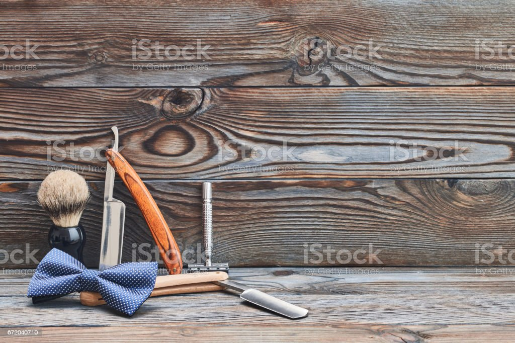 Vintage barber shop tools on wooden background stock photo