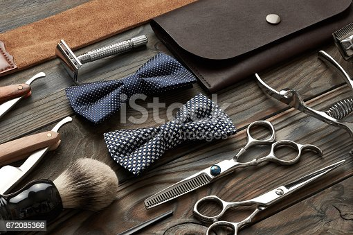 672088820 istock photo Vintage barber shop tools on wooden background 672085366