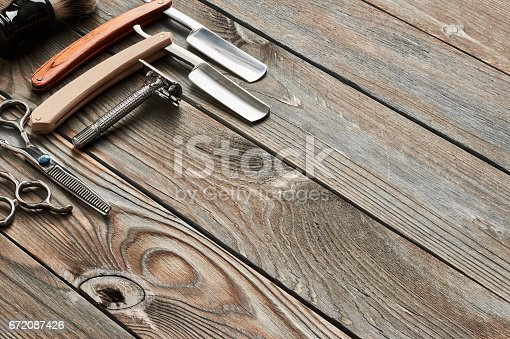 istock Vintage barber shop tools on wooden background 672087426