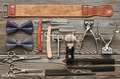 istock Vintage barber shop tools on wooden background 672087444