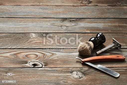 672088820 istock photo Vintage barber shop tools on wooden background 672088820
