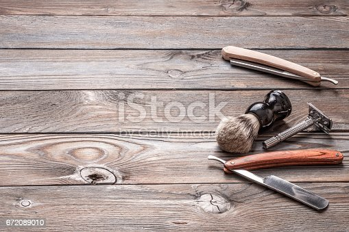 1126324804 istock photo Vintage barber shop tools on wooden background 672089010