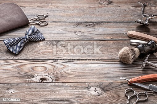 672088820 istock photo Vintage barber shop tools on wooden background 672089530