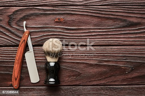 672088820 istock photo Vintage barber shop tools on wooden background 672089544