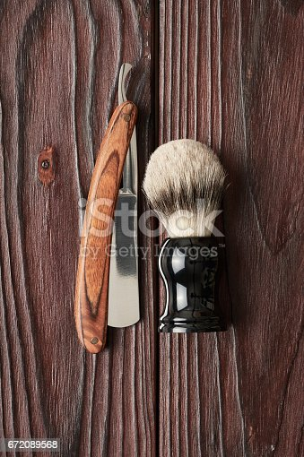 672089638 istock photo Vintage barber shop tools on wooden background 672089568