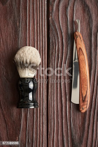 672089638 istock photo Vintage barber shop tools on wooden background 672089586