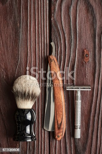 672089638 istock photo Vintage barber shop tools on wooden background 672089606