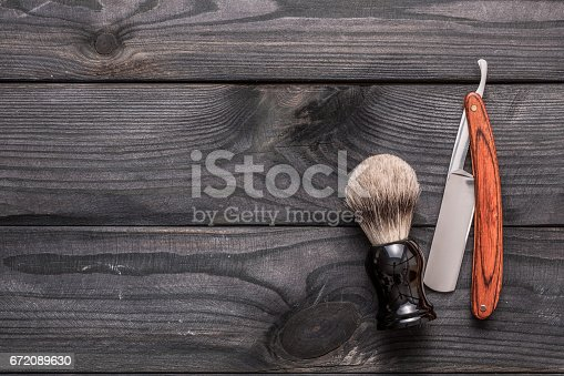 istock Vintage barber shop tools on wooden background 672089630