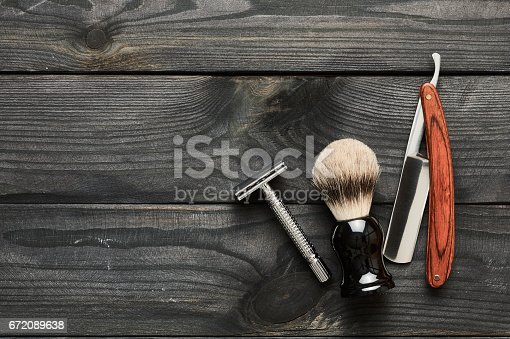 672088820 istock photo Vintage barber shop tools on wooden background 672089638