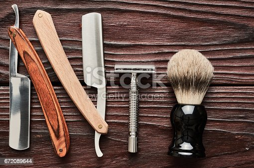 672088820 istock photo Vintage barber shop tools on wooden background 672089644