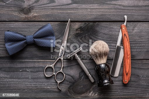 672088820 istock photo Vintage barber shop tools on wooden background 672089646