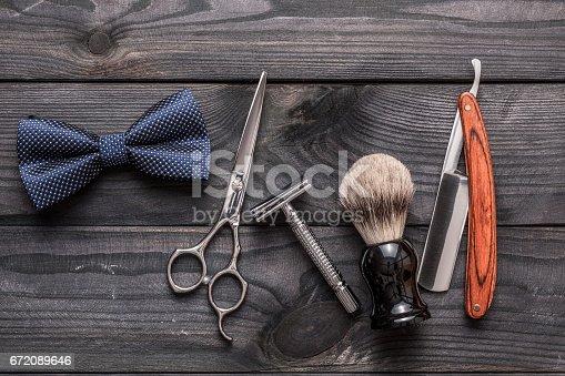 istock Vintage barber shop tools on wooden background 672089646