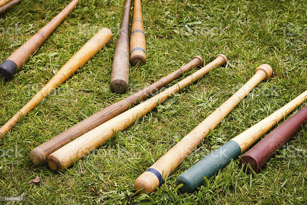 Vintage Baseball Bats Scattered on the Ground stock photo