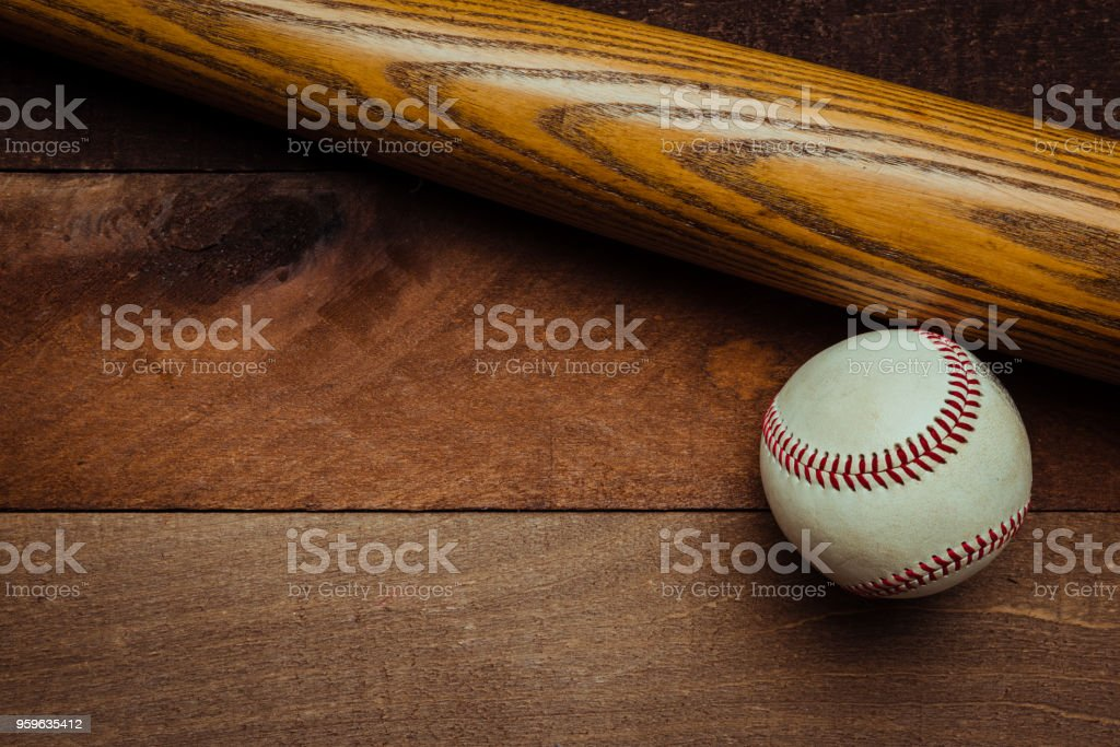 Vintage baseball gear on a wooden background stock photo