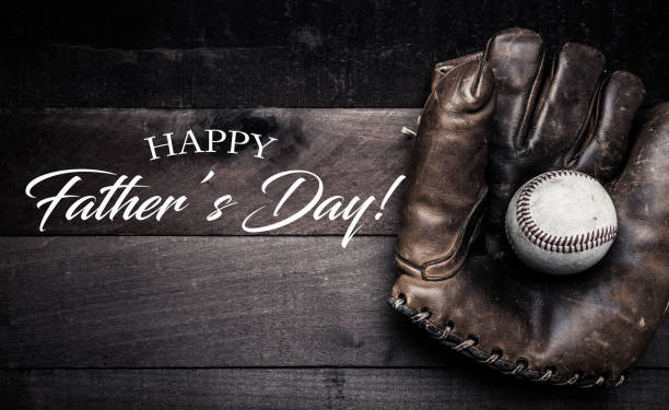Vintage baseball gear on a wooden background with Father's day greeting stock photo