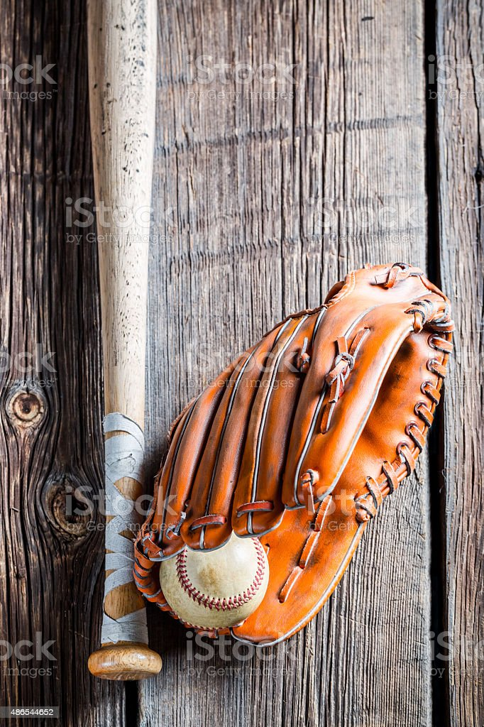 Vintage baseball glove and ball.