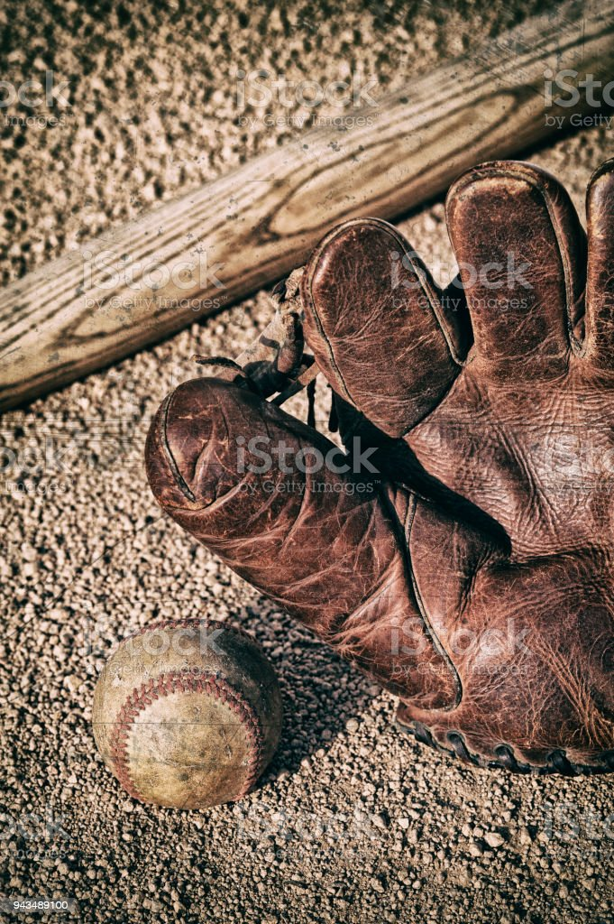 A vintage looking image of an old worn baseball, antique leather...