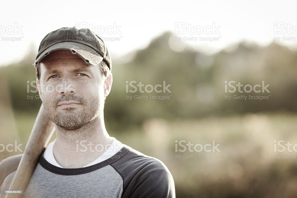 Vintage Baseball Player Holding Bat, In Outdoor Setting stock photo