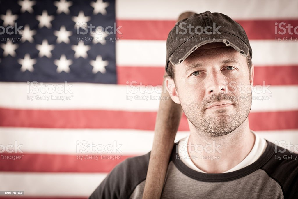 Vintage Baseball Player in Batting Stance, With American Flag Background stock photo