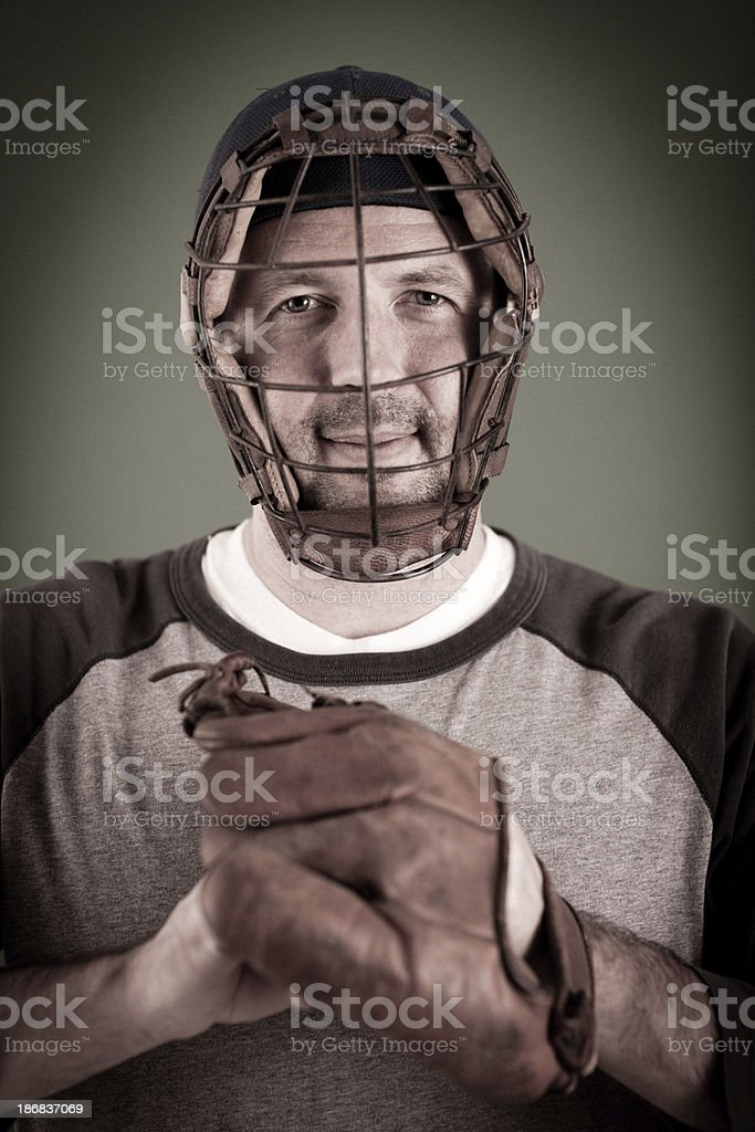 Vintage Baseball Player Standing with Ball and Mitt stock photo