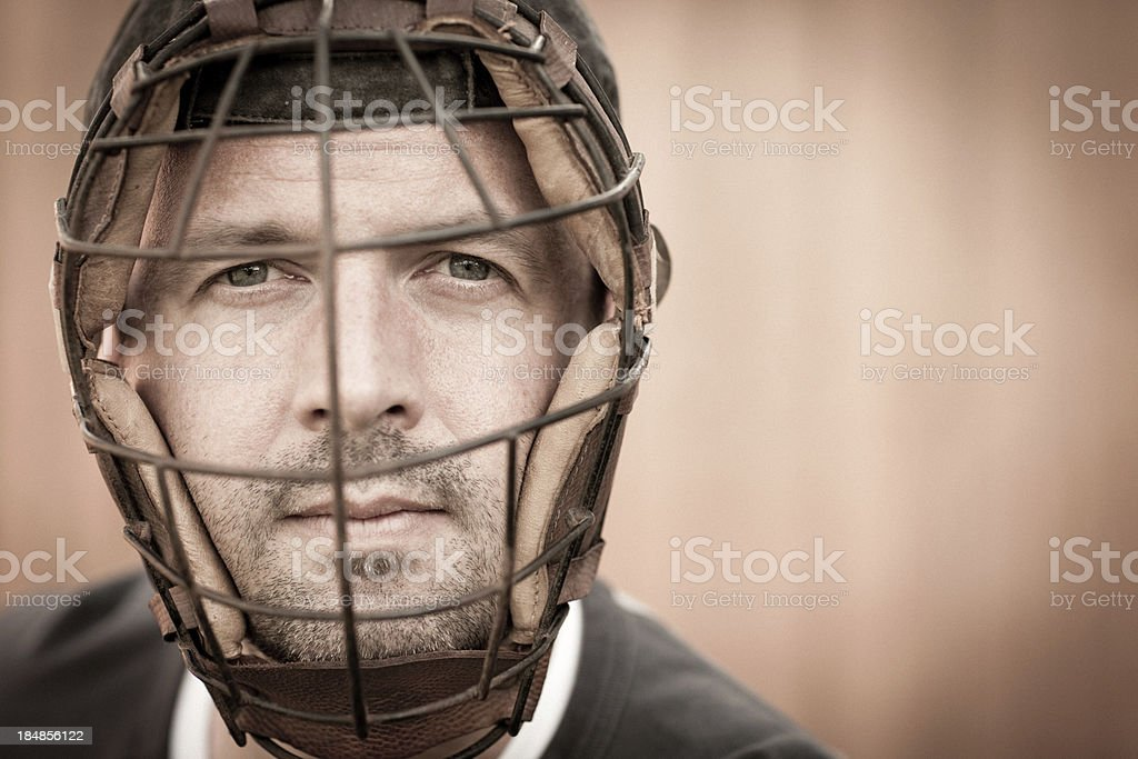 Vintage Baseball Player Wearing Catcher's Mask and Looking at Camera stock photo