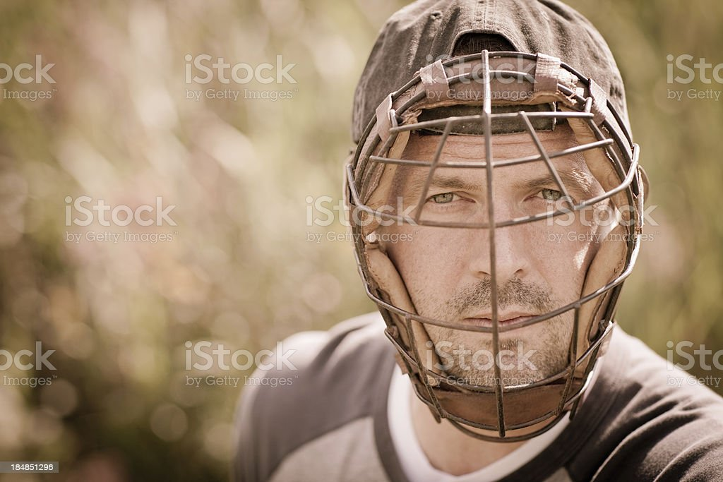Vintage Baseball Player Wearing Catcher's Mask, with Copy Space stock photo
