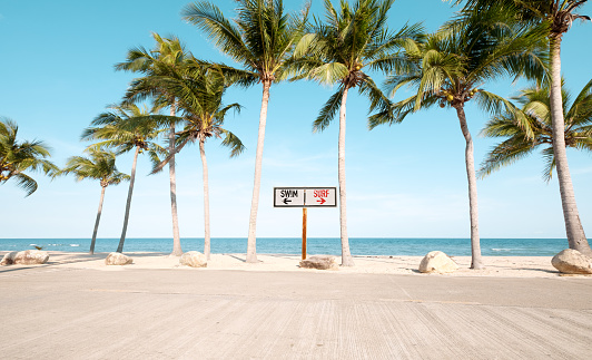 Vintage beach sign with surf