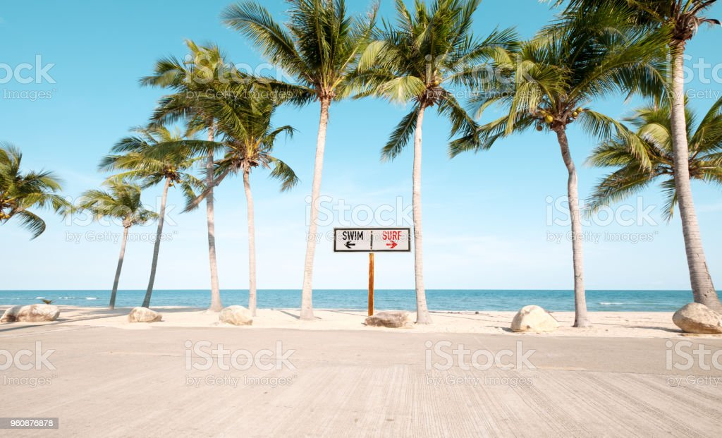 Vintage beach sign with surf stock photo