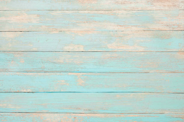 Vintage beach wood Vintage beach wood background - Old weathered wooden plank painted in turquoise blue pastel color. pastel colored stock pictures, royalty-free photos & images