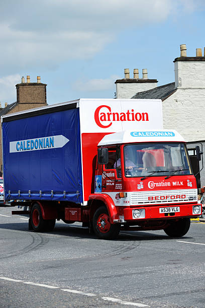 Vintage Bedord lorry on a Scottish street Castle Douglas, Scotland - July 30, 2011: A vintage Bedford TL 860 lorry taking part in a parade through Castle Douglas. The lorry is painted in the colours of Road Services Caledonian and Carnation evaporated milk. Road Services Caledonian hauled Carnation milk from the Dumfries factory until the mid 1970's. johnfscott stock pictures, royalty-free photos & images