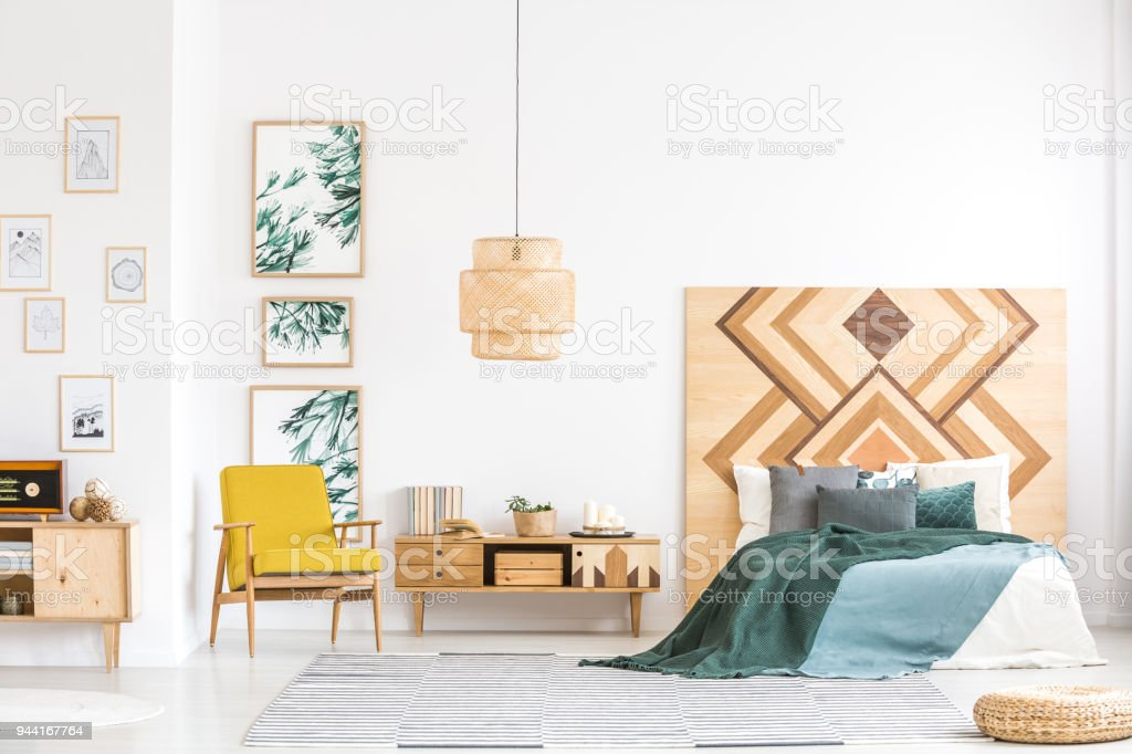 Vintage bedroom interior with wooden accents stock photo