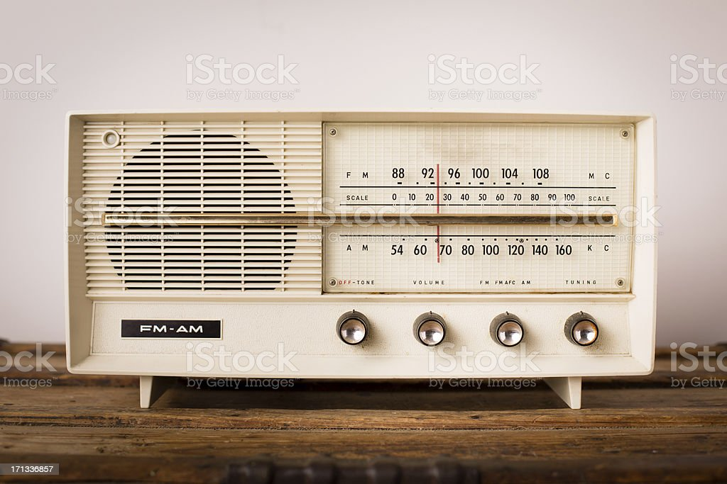 Vintage Beige Radio Sitting on Wood Table stock photo