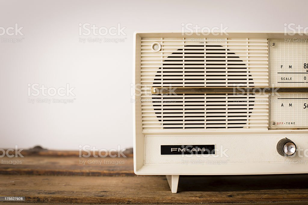 Vintage Beige Radio Sitting on Wood Table, with Copy Space stock photo