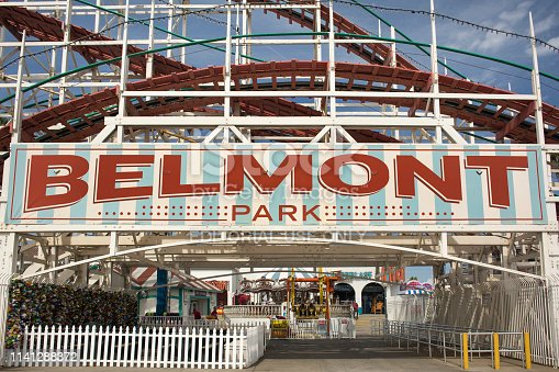 San Diego, California, USA: Horizontal shot of the colorful sign at the entrance of the retro Belmont Park amusement park with the iconic Giant Dipper wooden roller coaster behind, Mission Bay