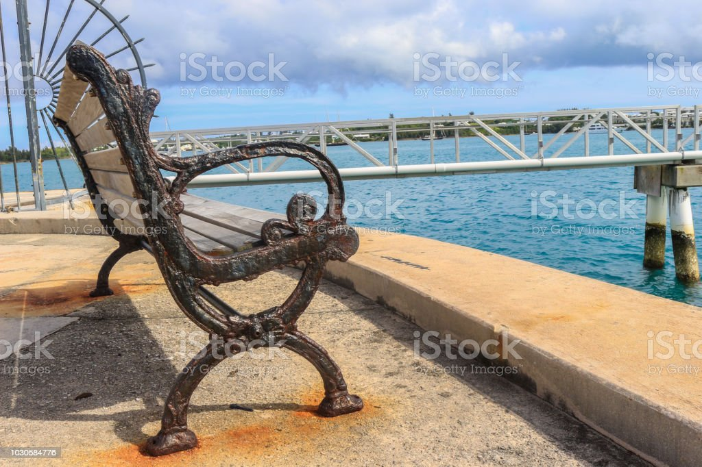 Vintage Bench by the Ocean stock photo