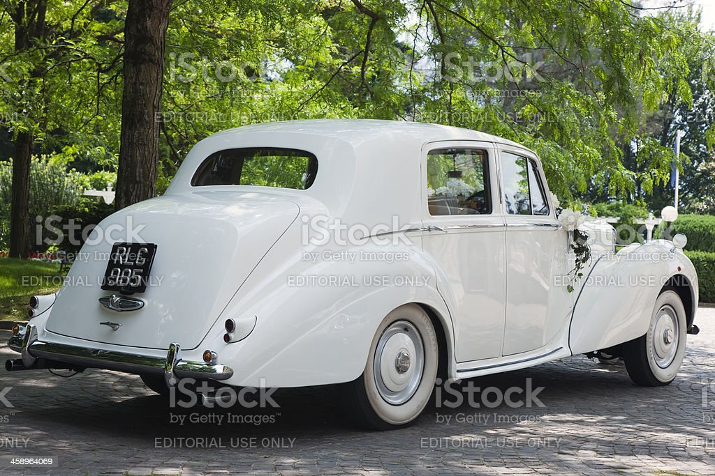 Vintage Bentley Wedding Car Decorated with Flowers royalty-free stock photo