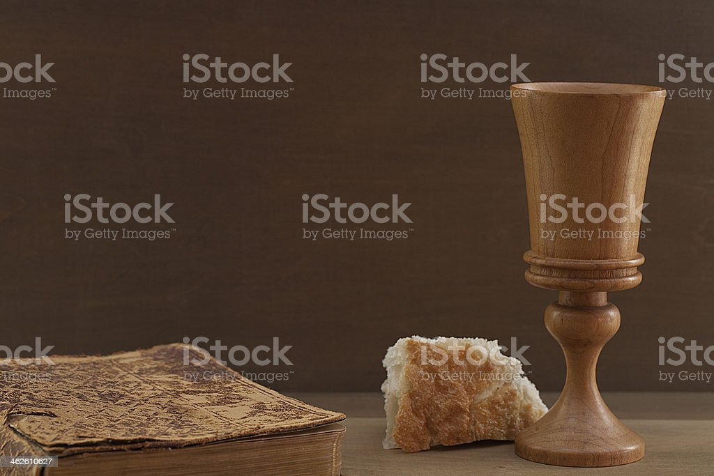 Vintage Bible, Bread and Wooden Cup stock photo
