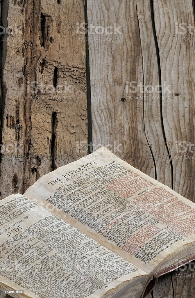 Vintage Bible opened to the book of Revelation stock photo