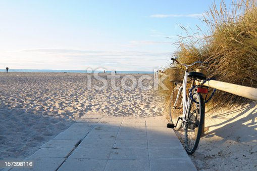 Bike leaning at wooden fence at the beach, Miami, USA.