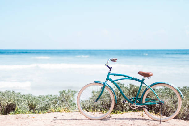 Vintage bicycle in front of the caribbean sea stock photo