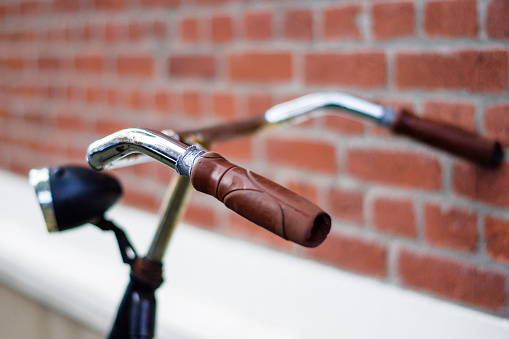 Vintage bicycle leaning on a bare brick wall