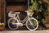 Old styled bike with basket of flowers