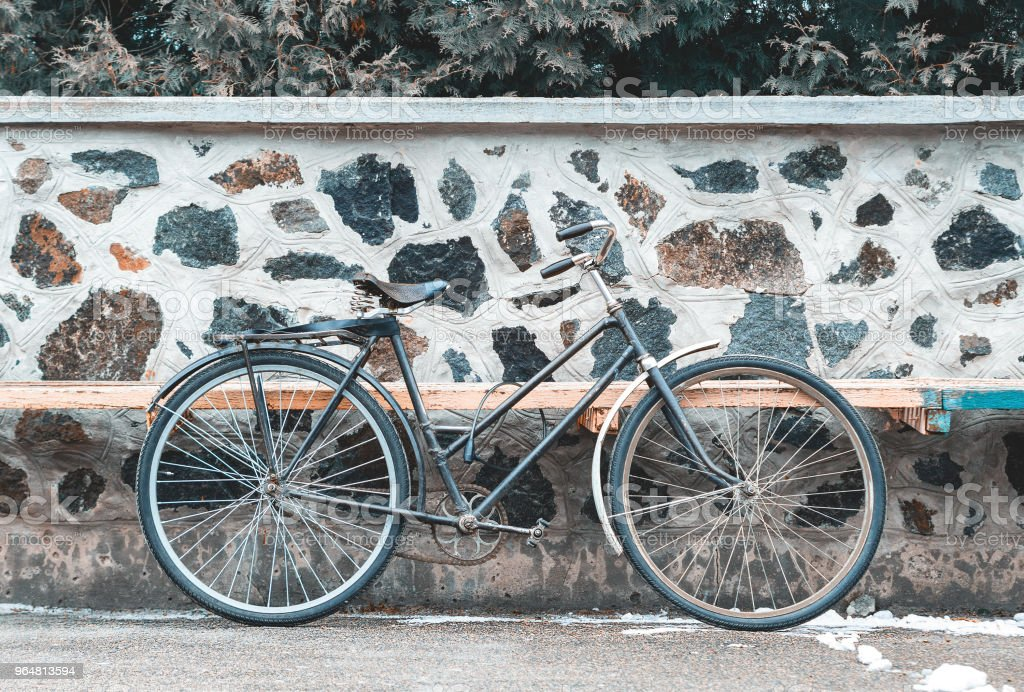 Vintage bicycle on the stone wall background royalty-free stock photo
